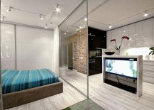 TV-that-can-be-viewed-both-from-living-area-and-bedroom-217x155