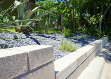 The retaining wall dips down to a lower level