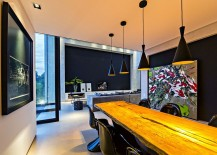 Tom Dixon pendant lights shine a spolight on the natural wood dining table