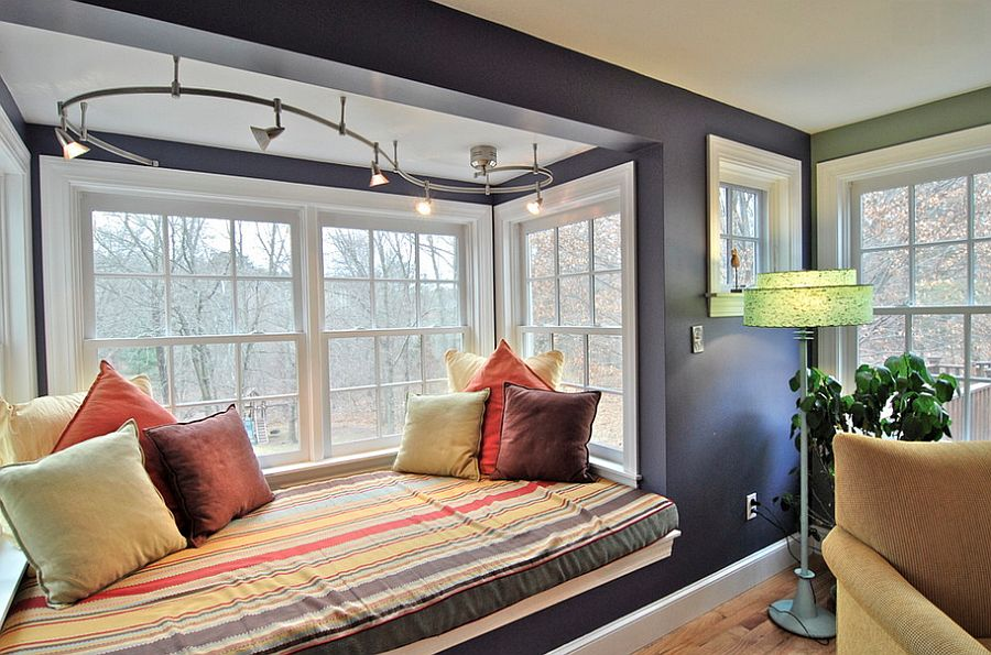 Track lighting adds beauty to the cozy window seat [From: Brenda Olde Photography]