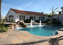 Traditional-pool-with-an-elegant-deck-in-concrete-217x155