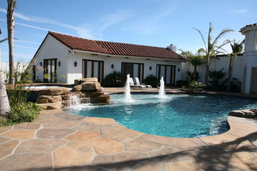 Traditional pool with an elegant deck in concrete [Design: Spragues' Ready Mix Concrete]