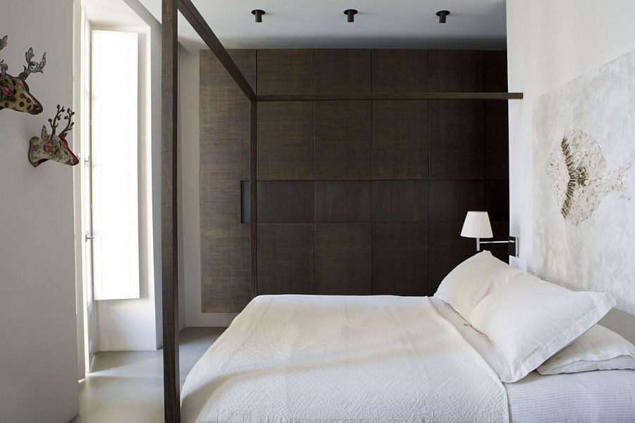 Tranquil, minimal bedroom with an organized design