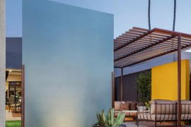 Trellis in a backyard with colorful accents  How to Style a Trellis Trellis in a backyard with colorful accents 270x180