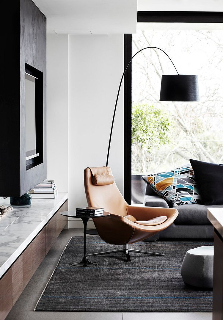 Trendy contemporary living room with a comfy reading corner [Design: Christopher Elliott Design]