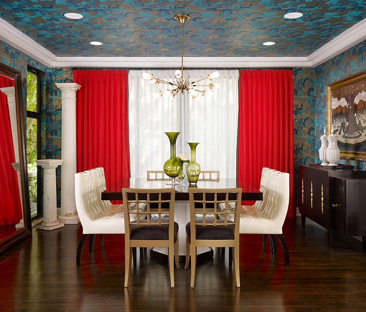 Trendy dining room draped in wallpaper