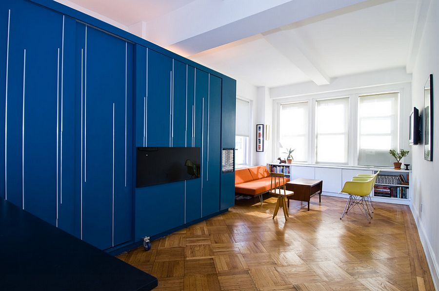 Trendy modern apartment with a Murphy bed wall unit and the Case Study Daybed in Orange