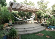 Tropical style landscape with pergola and hammock