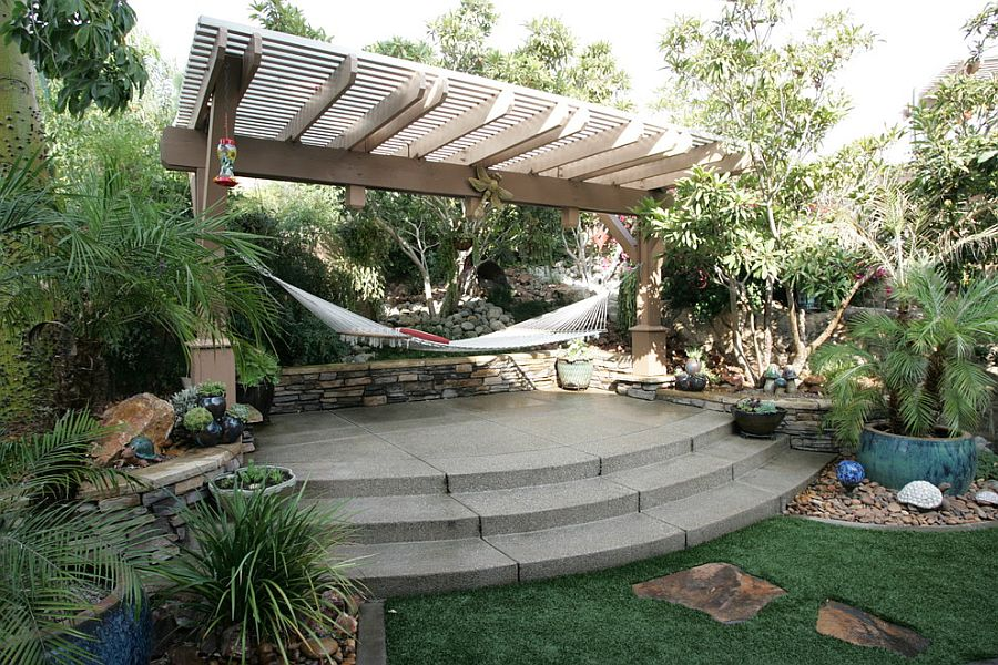 Tropical style landscape with pergola and hammock [Design: STB Landscape Architects]