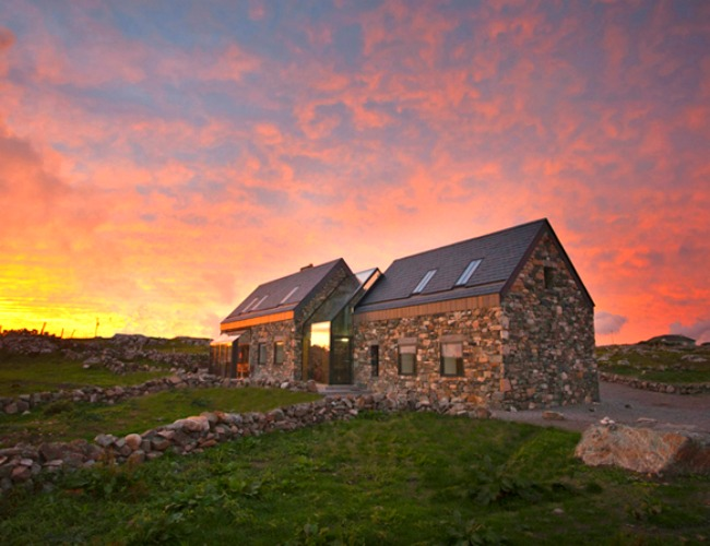 These stone cottages are joined by a glass wall