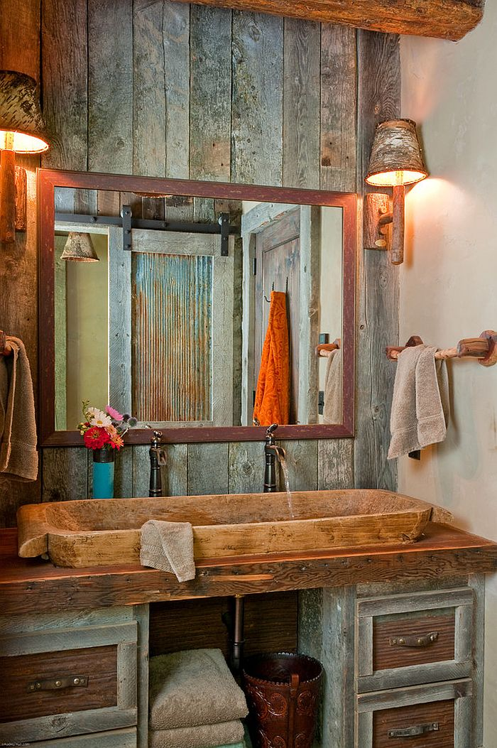 Vanity of the rustic bathroom draped in wood