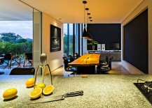 View of the lovely dining area in black and yellow from the kitchen