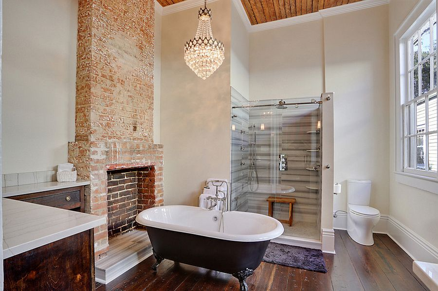 Vintage French chandelier adds glam to the transitional bathroom [Design: MLM Incorporated]