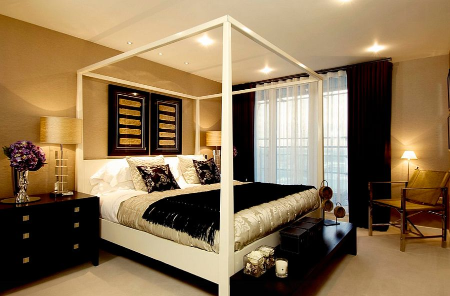 view in gallery wallpapered walls in gold and black decor and throws give the master bedroom a luxurious look