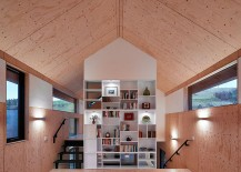 Wooden-structure-inside-the-stone-walls-of-the-mill-create-a-modern-home-217x155