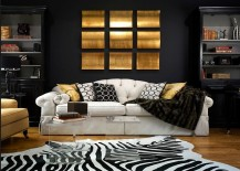 Zebra rug black backdrop along with gold accents for the living room 217x155 15 Refined Decorating Ideas in Glittering Black and Gold