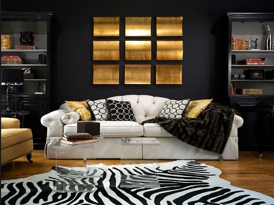 Zebra rug, black backdrop along with gold accents for the living room