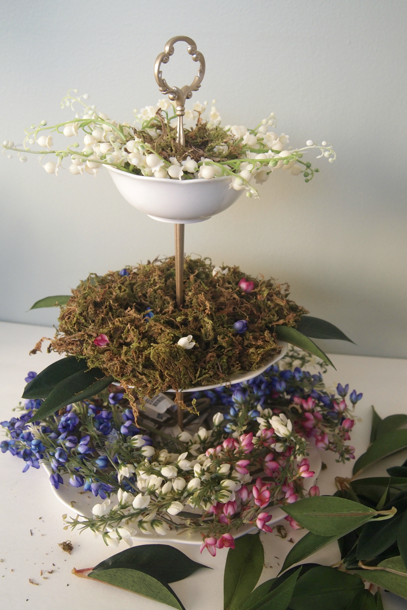 Add in leaves to the arrangement