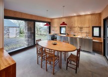 Pendant lights add pops of red to the kitchen