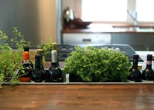 Awesome kitchen island combines the wine rack with herb garden