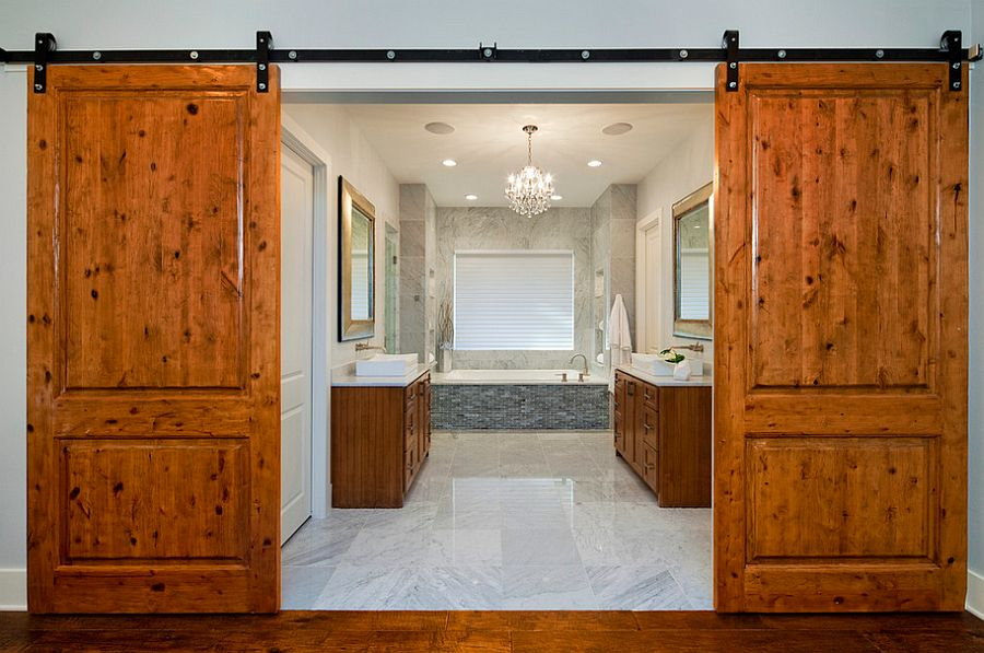 Barn doors bring rustic simplicity to the modern bathroom [Design: Cornerstone Architects]