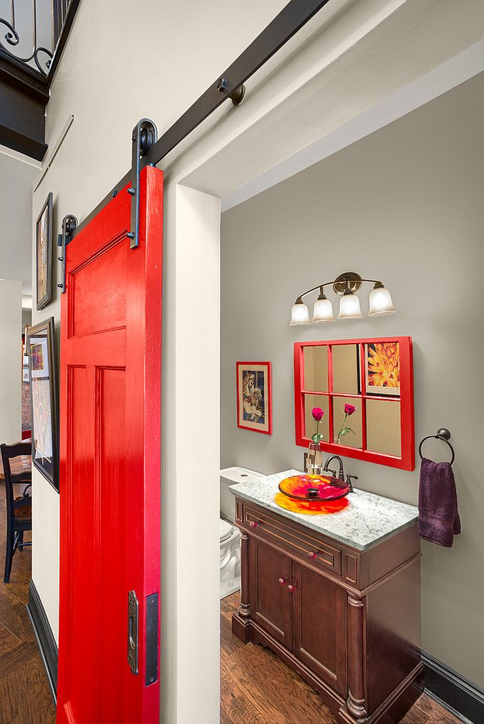 Bathroom door adds vivacious red to the setting [Design: Prime 1 Builders]