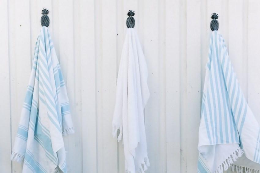 Beach towels on pineapple hooks