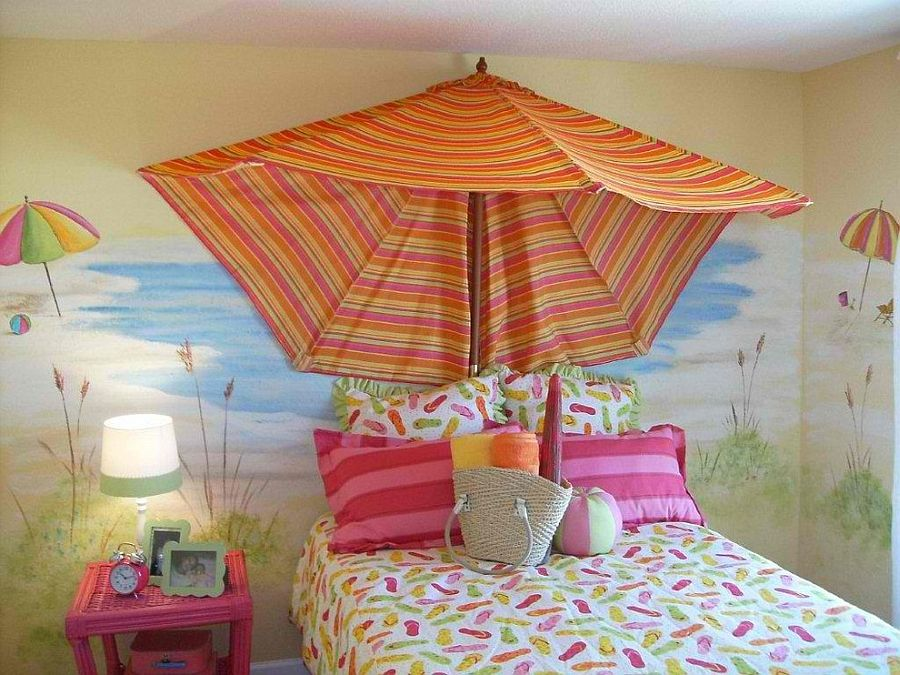 Beach umbrella used as canopy in the little girls' bedroom [Design: Anita Roll Murals]
