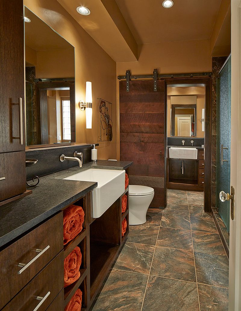 Beautiful bathroom barn door crafted from reclaimed Black Walnut lumber [Design: USI Design & Remodeling]