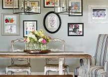 Beautiful gallery wall brings color to the relaxed dining room