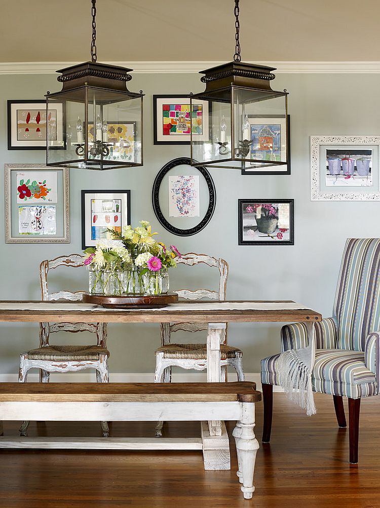 Beautiful gallery wall brings color to the relaxed dining room [Design: Verge Painting & Siding]