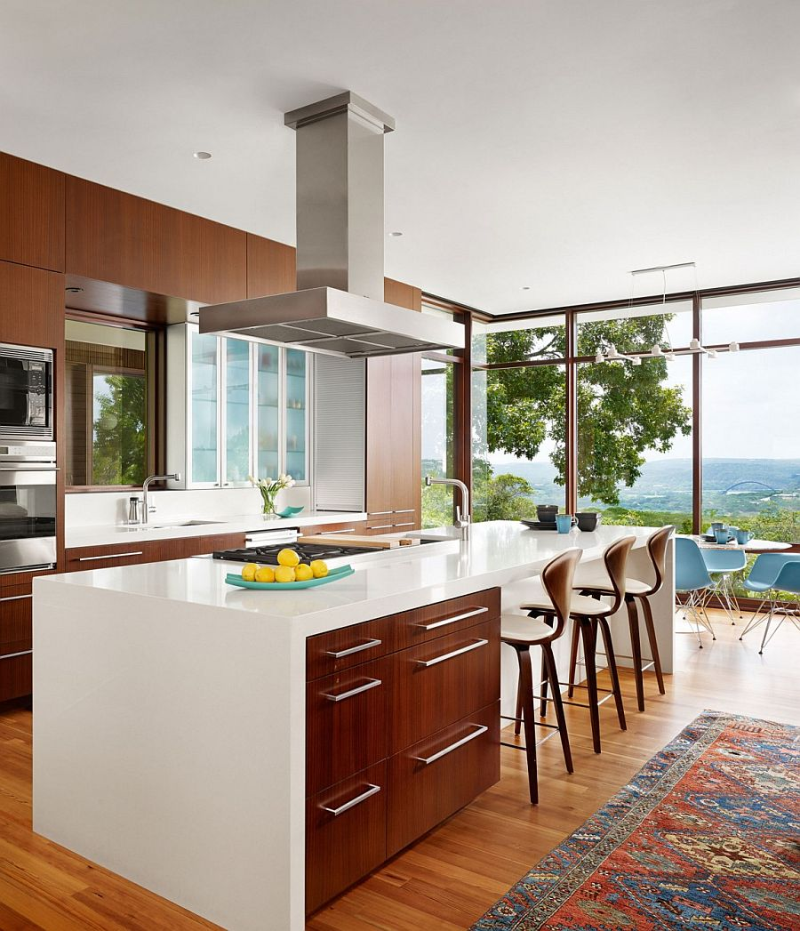 Beautiful modern kitchen of the Austin home with majestic views of the Bright Leaf preserve