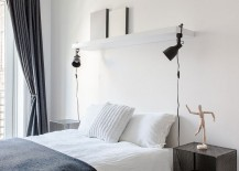 Bedside table and lighting bring symmetry to the relaxing bedroom