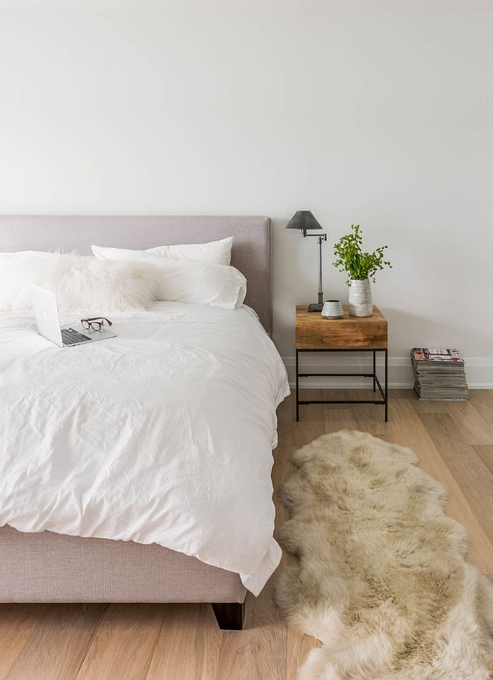 ... Bedside Table And Plush Rug Bring Warmth To The Cool Bedroom [Design:  Shirley Meisels