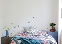 Bird decal in the backdrop steals the show in this classy bedroom