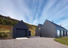 Black exterior of the home gives it a unique presence 217x155 Dashing Dark Exterior Shapes Striking Contemporary Home in Isle of Skye