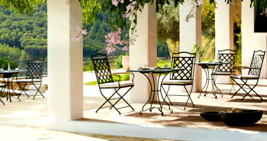 View in gallery These chairs will fold up when it's time for winter storage - 10 New Ways To Think About Wrought Iron For The Garden Or Patio