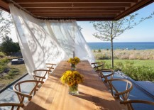 Breezy curtains by an outdoor dining table
