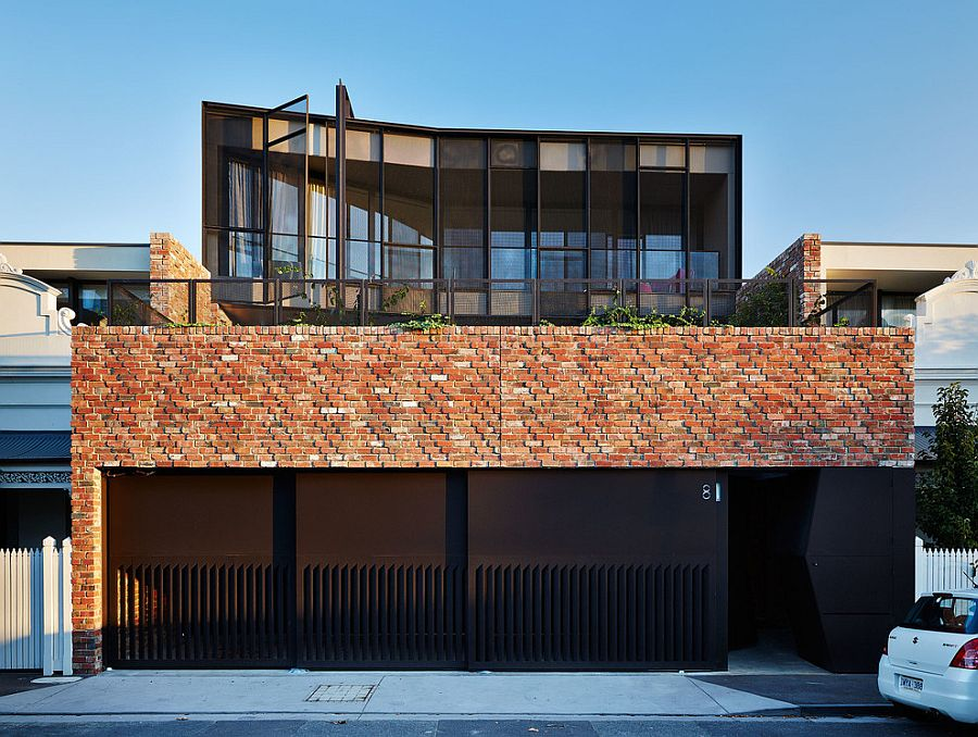 Brick and steel exterior of the warehouse-styled home with a creative entry