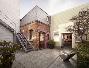 Brick exterior of the tiny boiler rool turned into a ultra-cool guest house