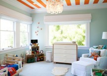 Bright orange stripes enliven the cool, modern bedroom