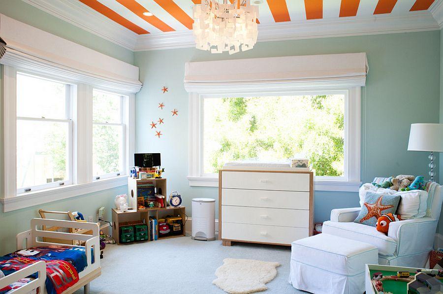 Bright orange stripes enliven the cool, modern bedroom [Design: Artthaus by Riaz Taplin]