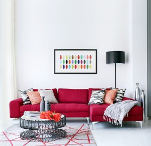 Bright red sectional enlovens the chic family living room
