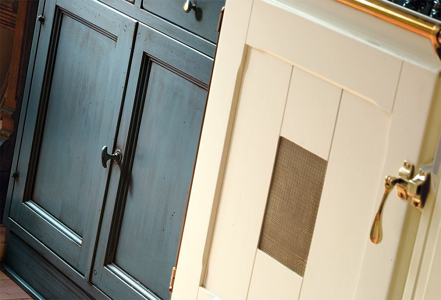 Cabinets painted in delicate pastel tones inside Doria kitchen