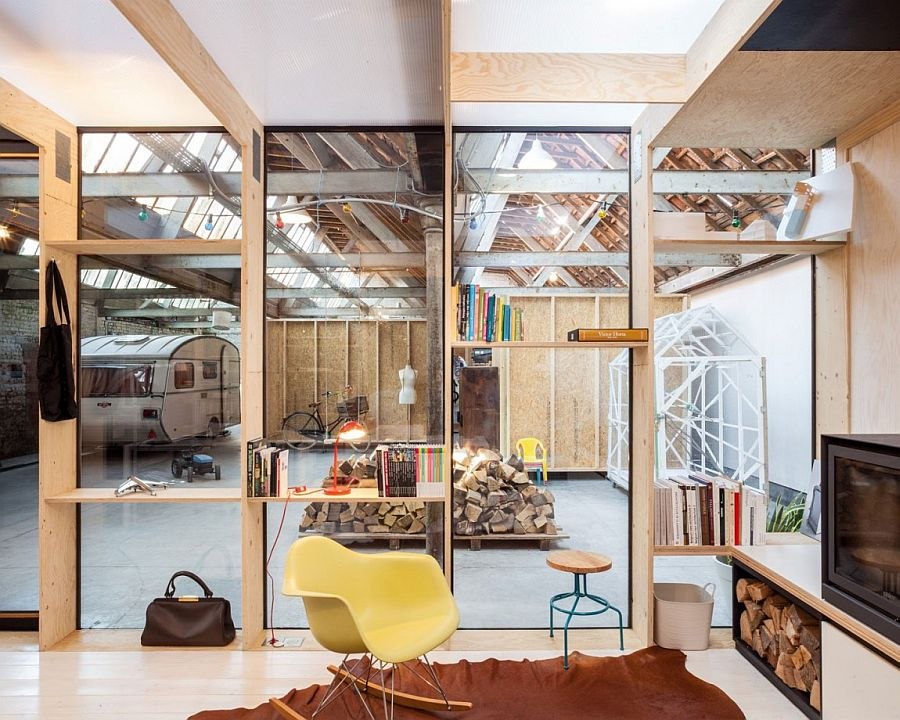 Classic Eames Rocker sits in front of the fireplace inside the home office
