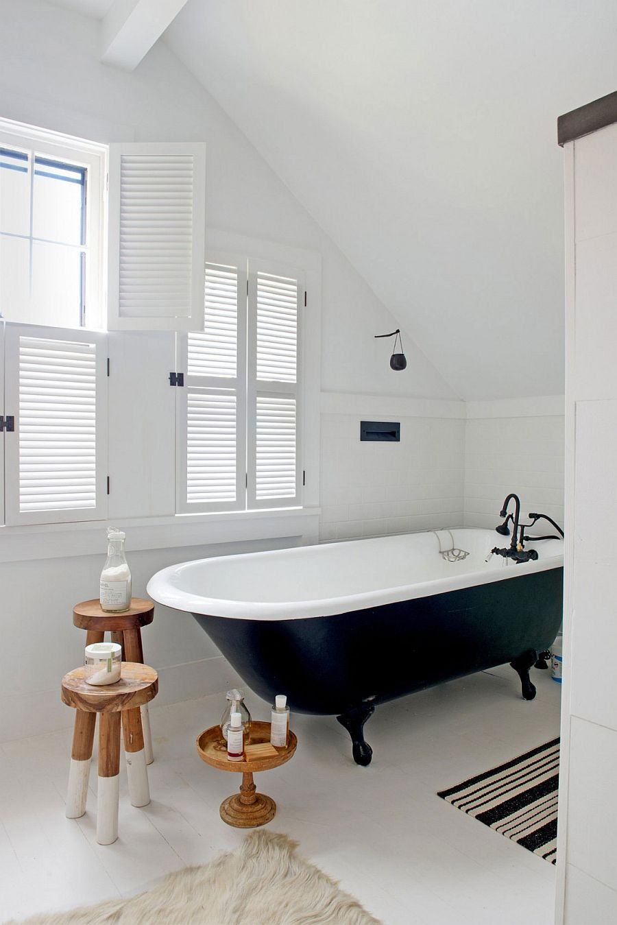 Claw-foot bathtub in the small bathroom in black and white