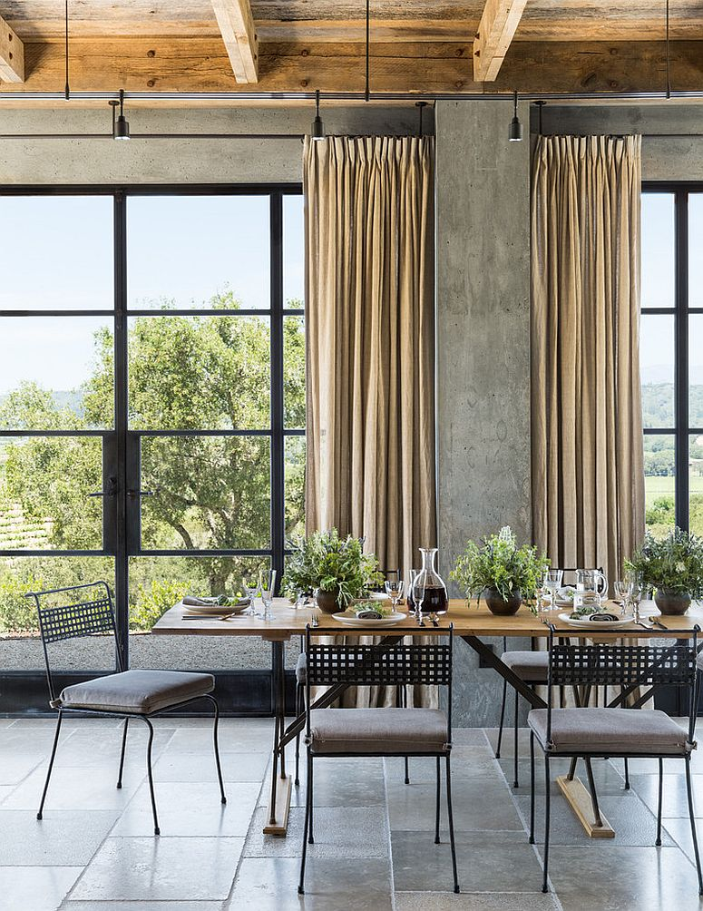 Concrete walls bring unassuming industrial simplicity to the farmhouse setting [Design: Jute Interior Design]