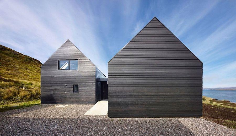 Contemporary home in Scotland with a dark exterior set in scenic landscape