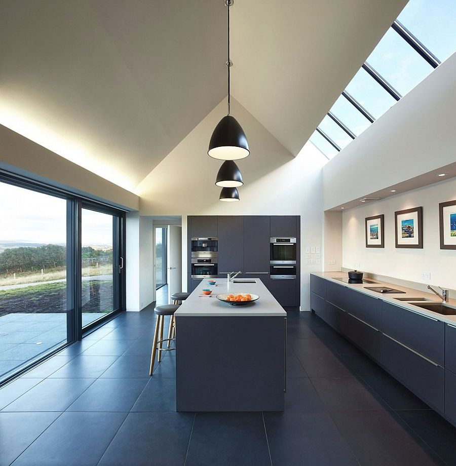 Contemporary kitchen design with large windows, skylights and black pendant lights