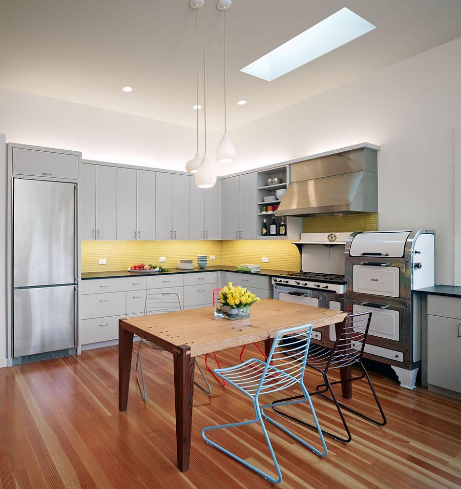 Contemporary kitchen with gray cabinets and yellow backsplash [Design: Chr DAUER Architects]